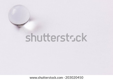 One clear glass marble - Upper left  - stock photo