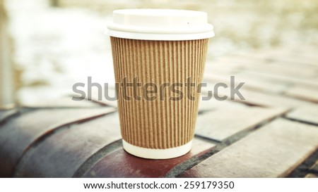 One coffee cup in the city  - stock photo