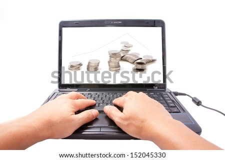 one computer notebook with graph and stack of coins photo - stock photo