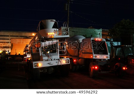 One Concrete Truck Coming, One Going, Nightime concrete pour of bottom floor of new Public Service Station in Downtown Roseburg OR - stock photo
