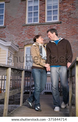 One couple holding hands - stock photo