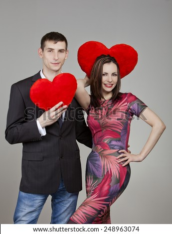 one couple in love with two red hearts in Valentine's Day - stock photo