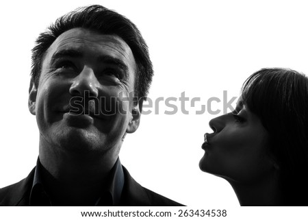 one  couple woman kissing man in silhouette studio isolated on white background - stock photo