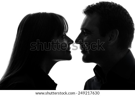 one  couple woman man in silhouette studio isolated on white background - stock photo