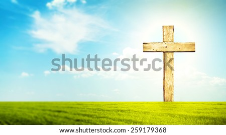 One cross in morning green field with blue heaven  - stock photo