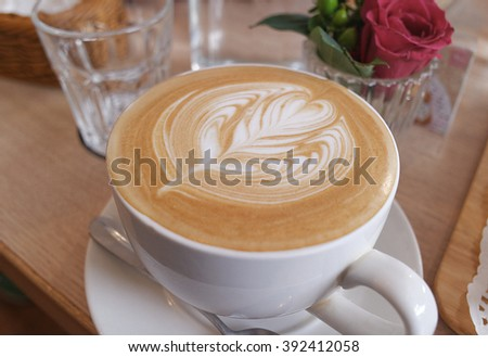 one cup of latte coffee close up - stock photo