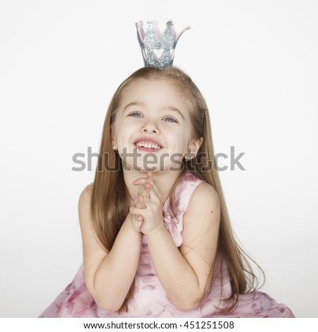 one cute girl child begging looking up and hoping for something. Princess kid holding hands together - stock photo