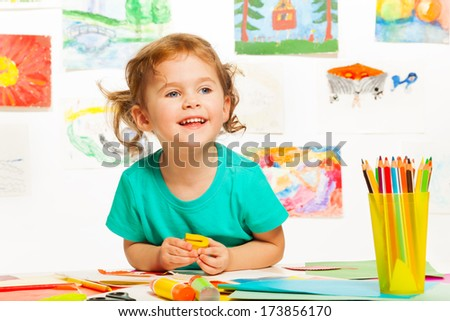 One cute smiling four years old girl on creative class smiling - stock photo
