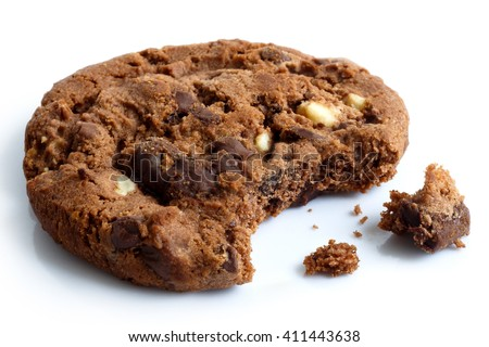 One dark chocolate chip cookie, bite missing with crumbs, isolated.