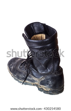 One dirty old boot on his left foot. Army boots. Isolated on white background. - stock photo