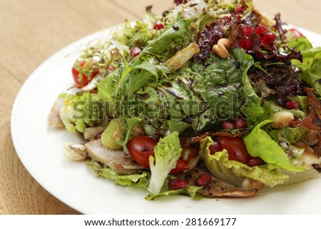 one dish of salad on wood table