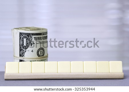 One Dollar and Copy Space for nine letters. - stock photo