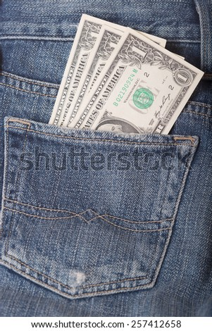 One dollar banknotes in the jeans pocket - stock photo