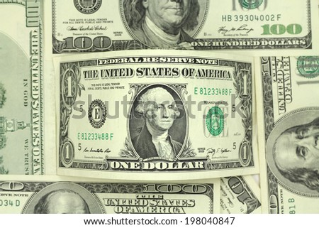 one dollar bill in abstract background