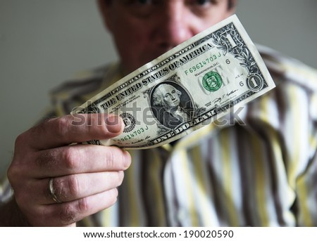 One dollar bill in the men's hand.