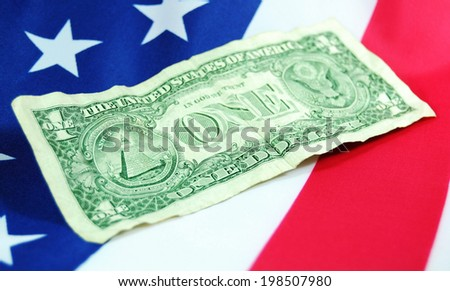 One dollar bill on US flag  - stock photo