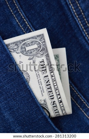 One dollar in denim pocket top view image - stock photo