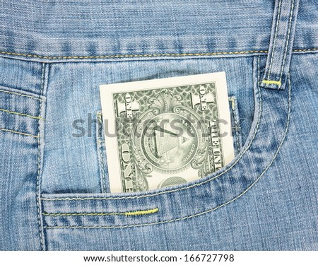 one dollar in jeans pocket  - stock photo