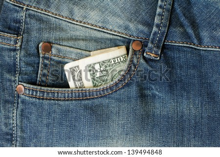 One dollar in the jeans pocket - stock photo