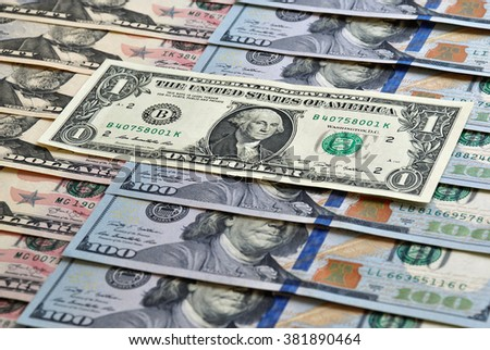 One dollar is on the other banknotes - stock photo