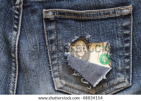 One dollar note inside hole in old jeans pocket - stock photo