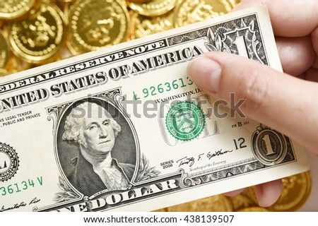 One dollars and gold coins for background