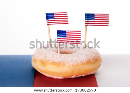 One Donut with three American Flags on Top, Isolated - stock photo