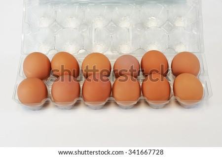 one dozen eggs in container - stock photo