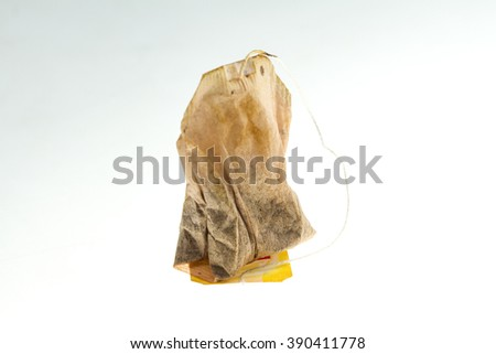 one dry tea bag on white background