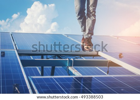 One electrician working on repair solar panel by replacement panel