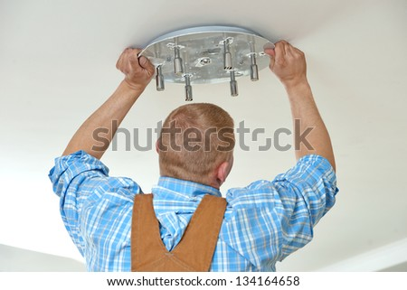 One electrician working with cable mounting and assembling new wiring - stock photo