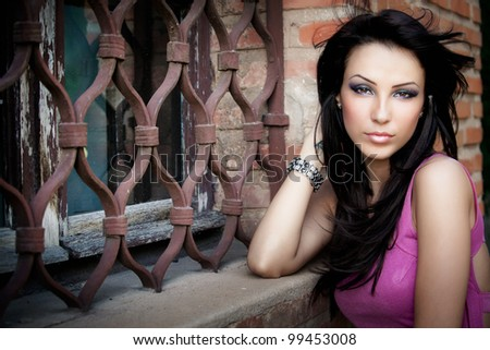 One elegant sexy beautiful young woman posing outdoor - stock photo
