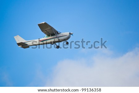 One engine small passenger aircraft taking off at airport - stock photo