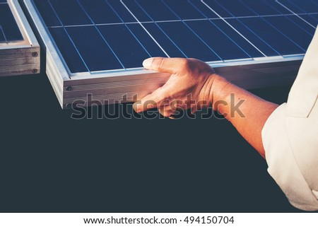 One engineer working on replacement solar panel in solar power plant