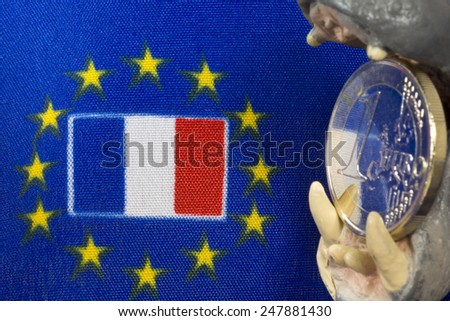 One Euro coin, Flag of France - stock photo