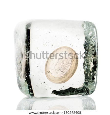 One euro coin frozen in ice cube - stock photo