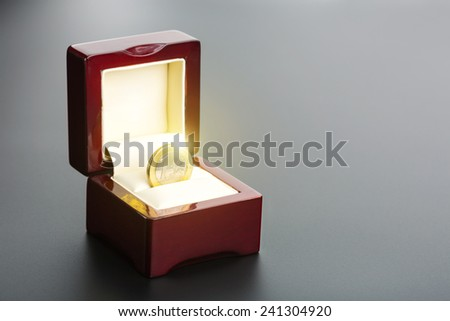 One euro coin in the box - stock photo