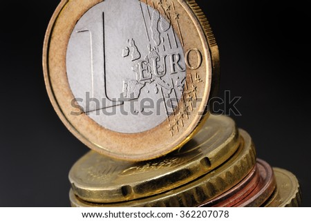 one euro coin on a black background