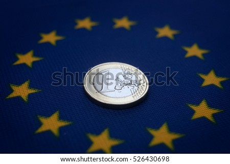 one euro coin on european flag.