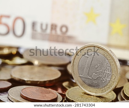 One euro coin on money background - stock photo