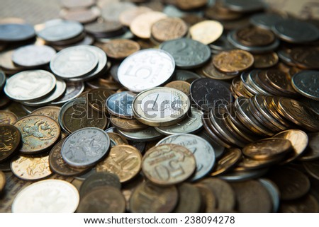one euro coin on russian  roubles coins - stock photo