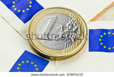 One euro coin with european union flag symbol from euro banknote revers - stock photo