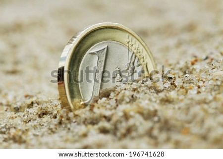 One euro grow on the sand. - stock photo