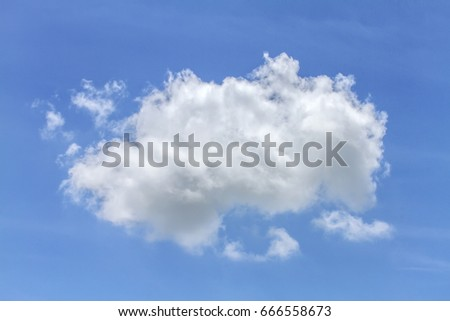 One fluffy cumulus cloud floating into the light blue sky