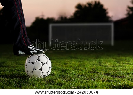 One football ball over green grass - stock photo