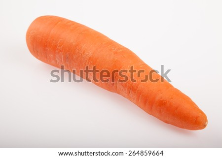 One fresh carrot root on white background