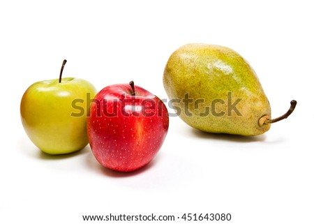 One fresh green pear and two apples in red and green color. With clipping path. Group of juicy ripe fruits.  Isolated on white background. - stock photo