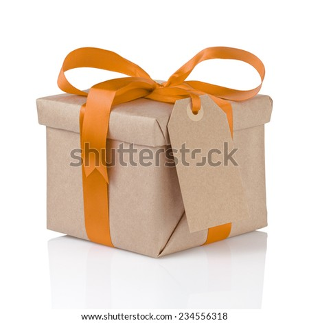 one gift christmas box wrapped with kraft paper and orange bow, isolated - stock photo