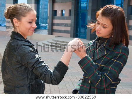 One girl boasts to another her new ring - stock photo