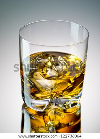 One glass of whiskey on the rocks - stock photo